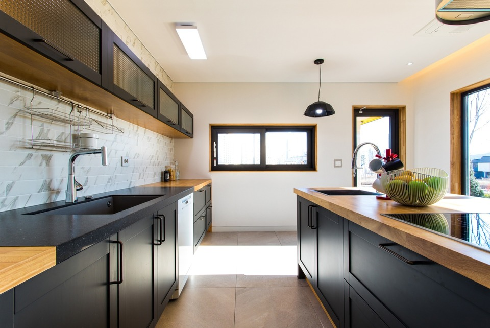 Newly built Kitchen leading to Garden by Jenkinson Potts.