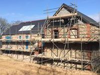 Property with scaffolding erected.